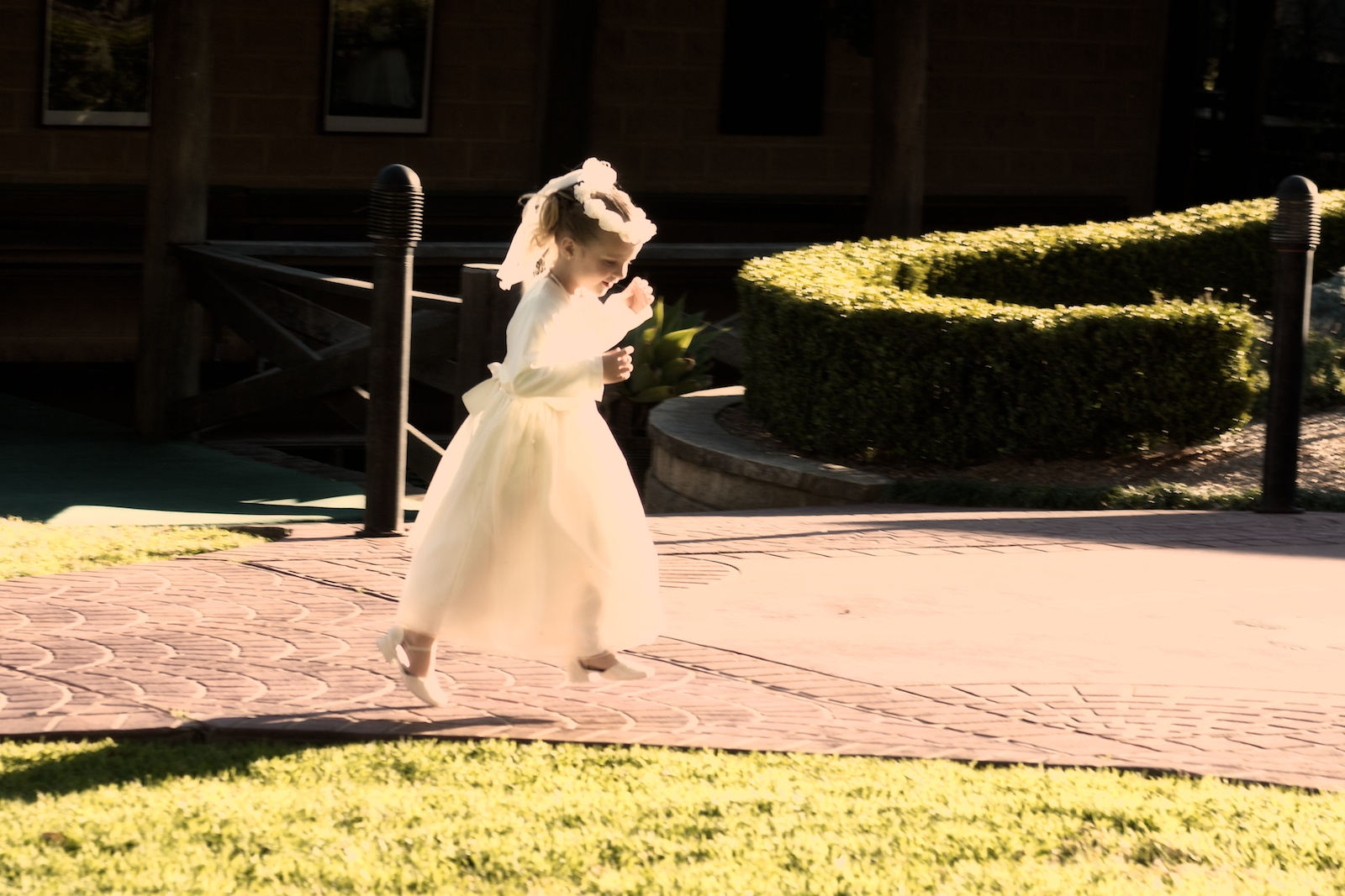 Wedding party, flower girl running