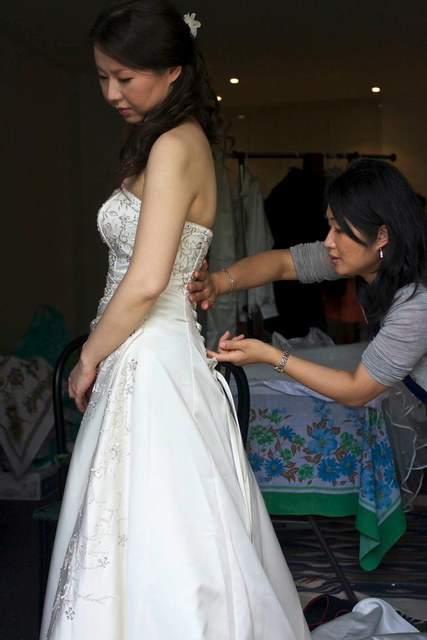 Doing up the wedding dress