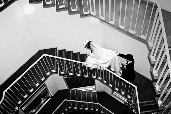 The bride and groom walk up the stairs